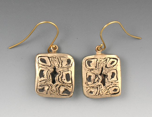 Holey bronze earrings
